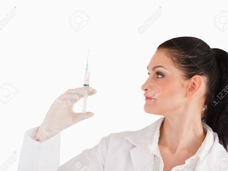 10231687-Female-doctor-preparing-a-syringe-on-a-white-background-Stock-Photo